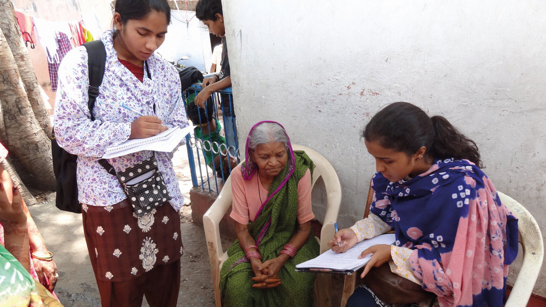 Data collectors test using the Washington Group questions out in the community in Bhopal, India.